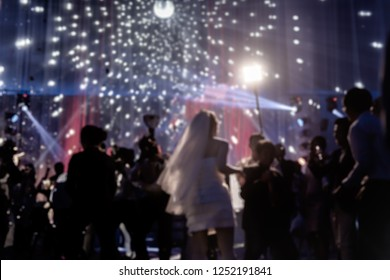 Blurred concept happy groom and bride dancing at wedding party with guest..