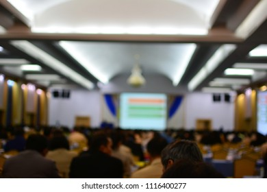 Blurred of conference hall or seminar room with attendee background.