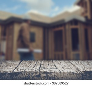 Blurred Construction Worker Inspecting Home Construction Site with Retro Style Filter