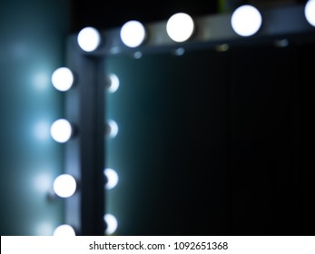 Blurred of The Corner of Make-up Mirror with Light Bulbs with Space