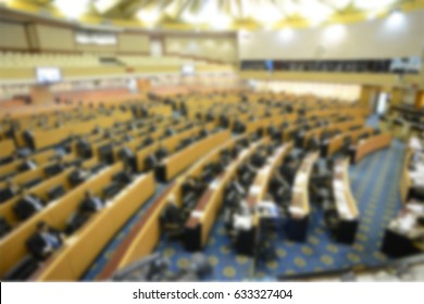 Blurred council meeting.