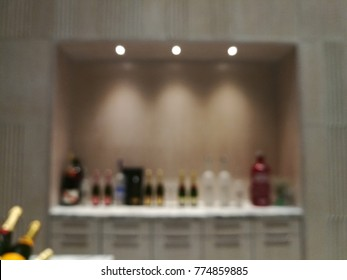 Blurred counter bar with alcohol beverage such as vodka, champagne, beer and rum in the hotel. And for those who enjoy drinking hobby