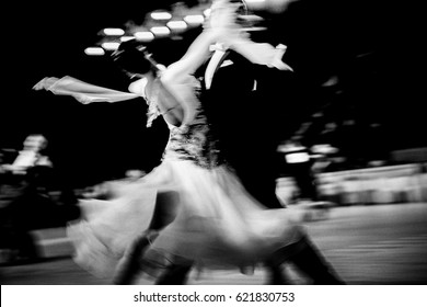 blurred couple dancers competition in ballroom dancing. black and white image