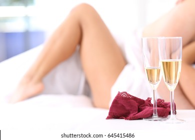 Blurred couple having sex on a bed in an hotel room or apartment after a celebration