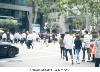 Blurred crowd of anonymous people, businessmen walking, crossing the road on zebra crossing in the city, Seoul, Korea. Vintage style