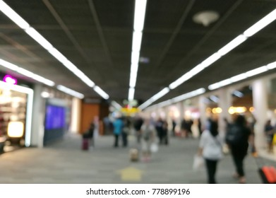 Blurred crowd moving for shopping at Airport terminal.