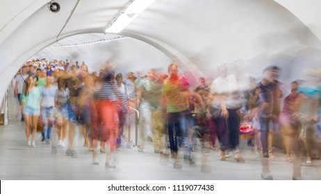 Blurred crowd of people moving on the transition between underground stations
