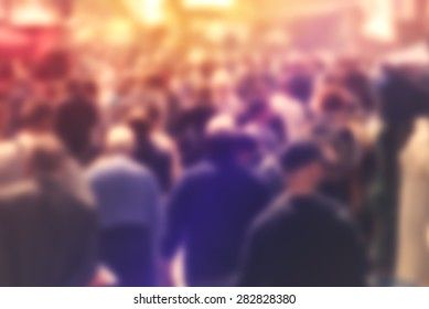 Blurred Crowd of People On Street, unrecognizable crowded population as blur urban background, Vintage Toned Image.