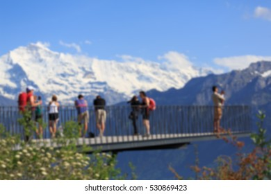 Blurred Crowd of People, unrecognizable crowded population as blur background.A view on Harder Kulm, above Interlaken.