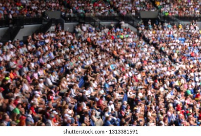 Blurred crowd spectators at a major grand slam tennis competition.
