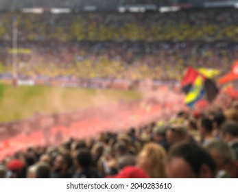 Blurred crowd of spectators on stadium at a sporting event