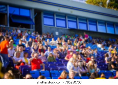 Blurred crowd of spectators on a stadium tribune at a sporting event