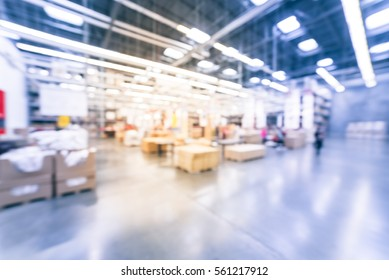 Blurred customers shopping in large furniture warehouse with forklift, cart. Row aisle, bins from floor to ceiling. Industrial storehouse interior. Inventory, wholesale, logistic, export. Vintage tone