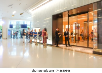 Blurred of Customers standing in front of the shop.