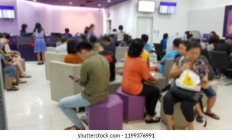 Blurred of customers waiting for the quque, deposit, withdraw, money transfer, bill payments, pay in, loan.