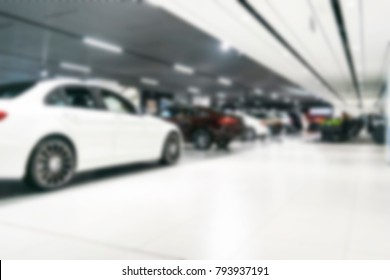 Blurred dealership store bokeh background, Cars soft lightning, Blur bokeh transportation concept dealer showroom background. Blurry