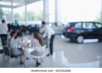 Blurred dealership store, with the cars and soft lightning., new car pictures in the showroom,  show waiting for sales of branch dealers and new car service centers.