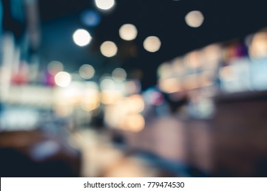 Blurred or defocus image of coffee shop, cafeteria or pub use for background.