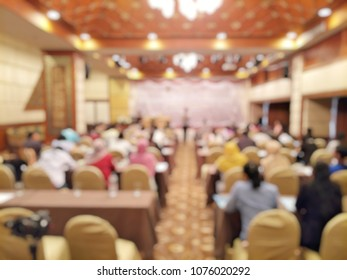 Blurred defocus image of many people there are seminars in event hall of hotel.