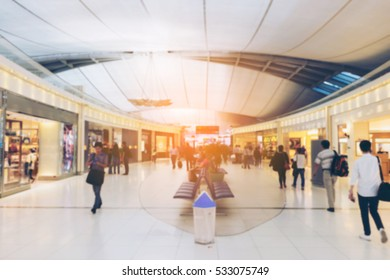 Blurred or Defocus shop and shopping mall at the airport with vintage tone