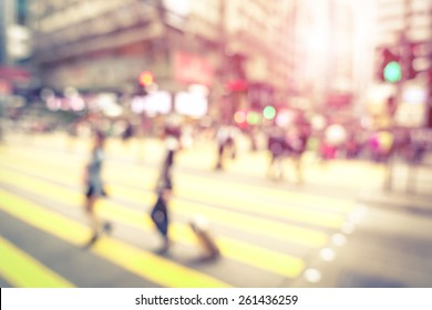 Blurred defocused abstract background of people walking on zebra crossing with vintage marsala filter - Crowded Nathan Road street in Hong Kong city center during rush hour in urban business area
