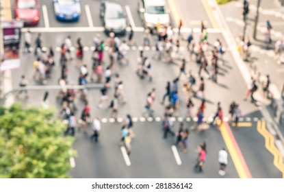 Blurred defocused abstract background of people walking on the street in Orchard Road in Singapore - Crowded city center during rush hour in urban business area zebra crossing - View from building top