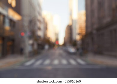 Blurred defocused abstract background of zebra crossing in urban business area