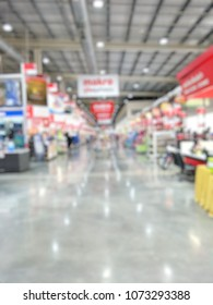 Blurred defocused background image of retail store or generic supermarket with some people for shopping,business,finance concept