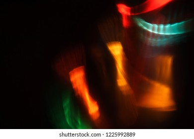 blurred defocused color light flashes and rays. lens flare effect. creative abstract background. festive disco nightlife atmosphere