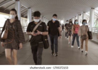Blurred defocused. The crowd is wearing protective masks prevent Coronavirus, Covid 19 virus during virus outbreak and PM2.5 air pollution crisis rush hour Bangkok, Thailand.