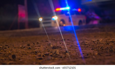 Blurred Defocused Emergency light of a rescue vehicle during midnight street accident.