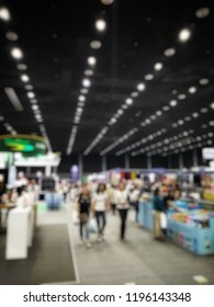Blurred defocused image of many people shopping or walking in the event hall for illustration shopping,business,finance background concept.