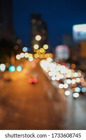 Blurred defocused lights of heavy traffic. Abstract blur image of night light bokeh on street. Blur traffic road with colorful bokeh light. Copy space of transportation and travel concept.