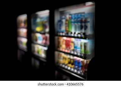 Blurred / Defocussed abstract background of colorful soft drinks / juice bottles vending machines, taken in Japan