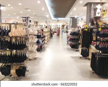 Blurred department lingerie of woman in shopping mall