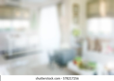 Blurred dining table next to sofa set in modern interior multipurpose area