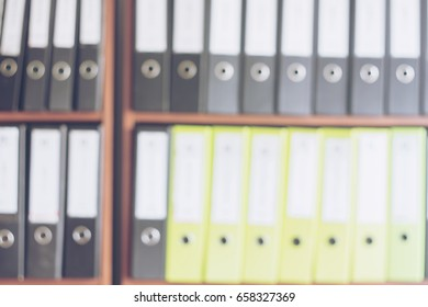 blurred of document file on the shelves at office