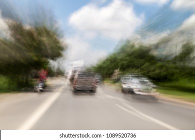 Blurred and double vision while driving with view of the road and feeling of speed.