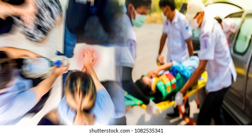 Blurred education healthcare first aid of CPR training medical procedure, demonstrating chest compression on CPR doll ,emergency training for safe life from car accident transfer moving to ambulance.
