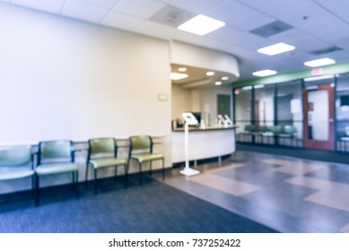 Blurred empty lobby/front desk area of clinical laboratory services office. Kiosk tablet for customer check-in on upon arrival. Test center for diagnostic testing, medical, healthcare concept. Vintage