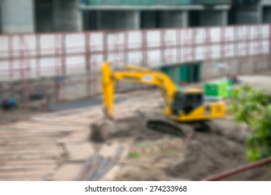 Blurred excavator on a construction site