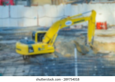Blurred excavator on a construction site.