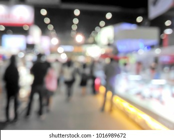 Blurred fair trade and people with colorful bokeh background