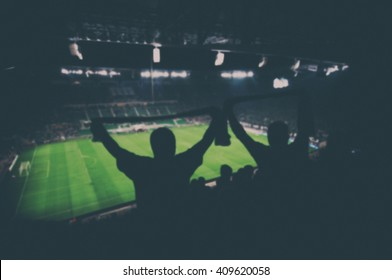 blurred fans on football stadium, vintage effect