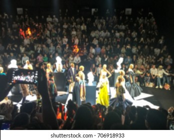 Blurred Fashion show runway , catwalk event , Spectators enjoy watching and taking photo models walk
