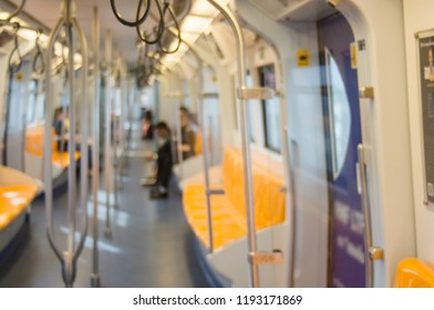 Blurred -  few people, and in  Metro not time rush. With concept of travel with public services in capital, convenient and modern.