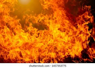 Blurred fire flame burning on dark background