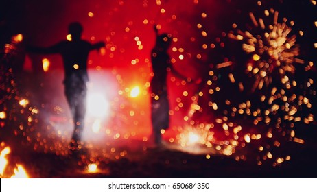 Blurred fireworks on beach at night fire-show performance