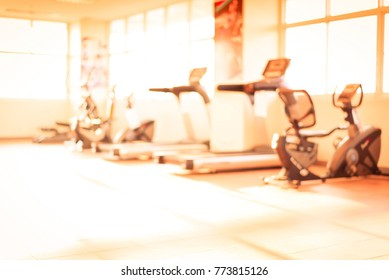 Blurred fitness equipment in luxury gym.Sport tools in training class room.