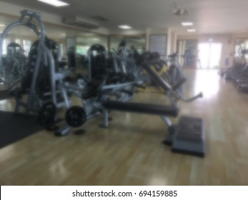 Blurred of fitness gym background and fitness center lifestyle with health exercise equipment
